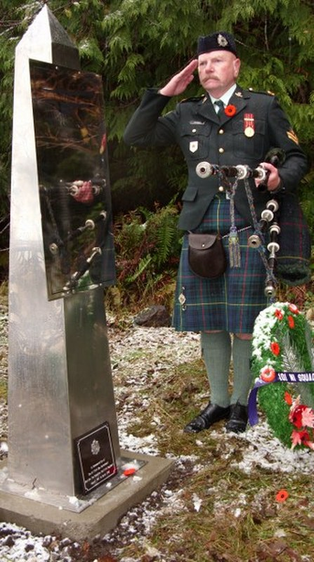 16 The Piper dedicating Regimental Plaque